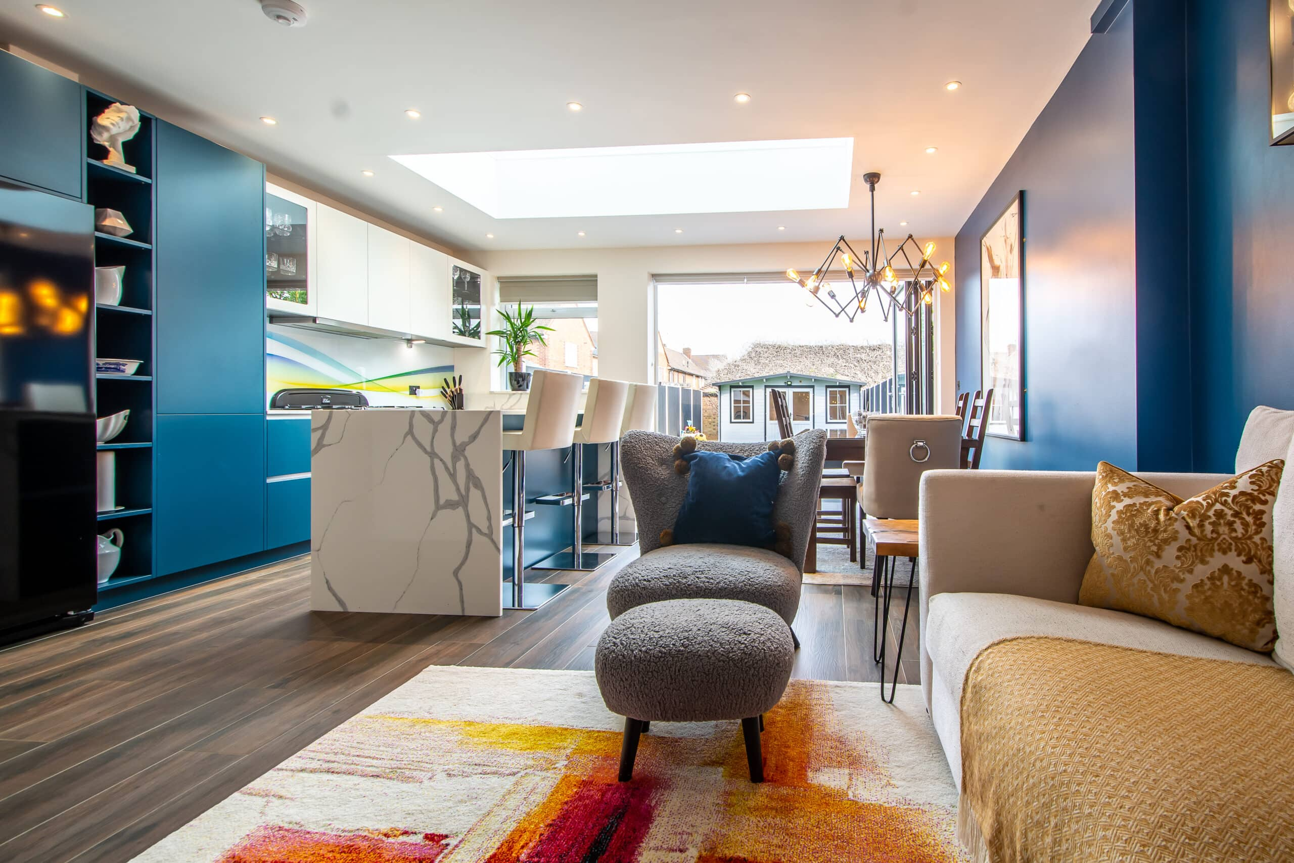 Smart new kitchen with cream units and granite worktops